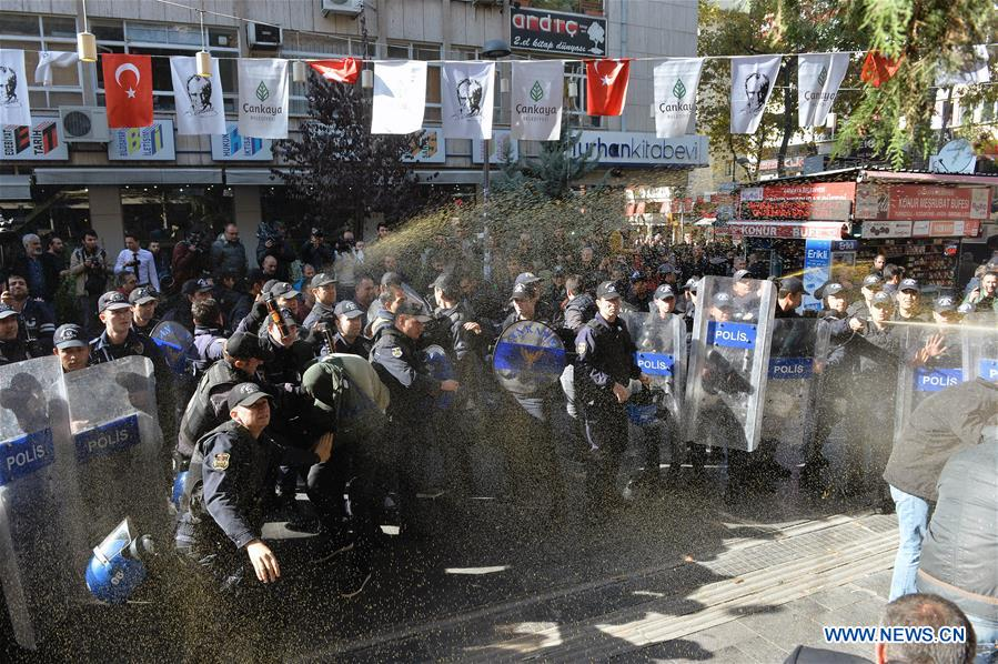 Policemen clash with protestors during a protest rally against the detention of co-leaders of Turkey