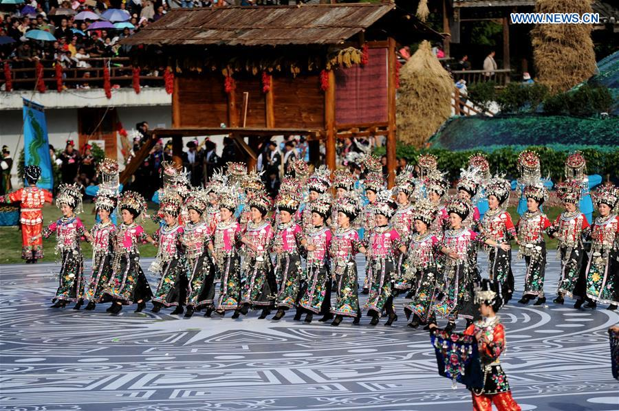 People of Miao ethnic group perform during a fair to celebrate their new year in Leishan, southwest China