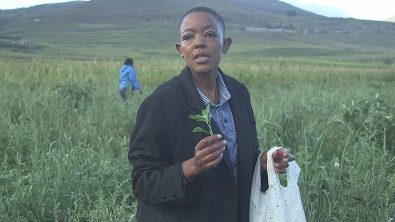 Ska Moteane from Lesotho showing a kind of plant that is used as vegetable. She is an award winning Basotho chef for promoting traditional Basotho recipes.