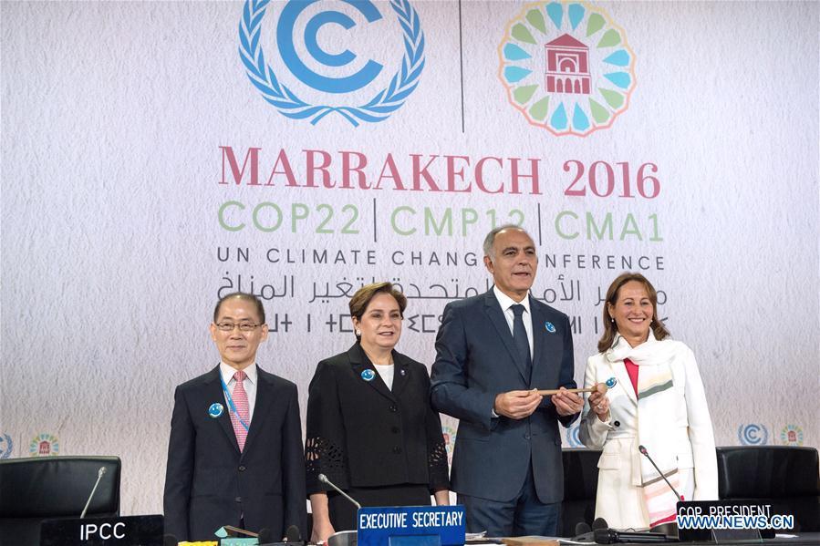 COP21 president Segolene Royal (1st R) hands over the presidency to Morocco