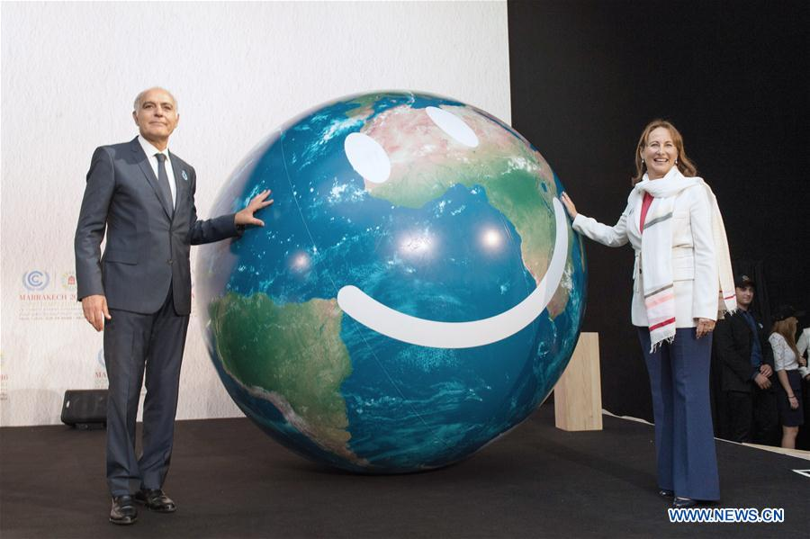 COP21 president Segolene Royal (R) and Morocco
