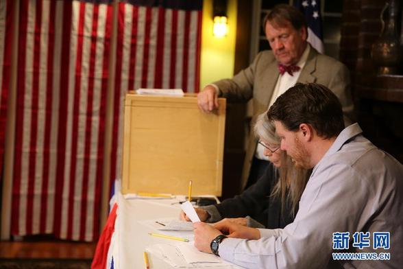 US Election Day got off to its usual early start in a village in New Hampshire at midnight Tuesday.