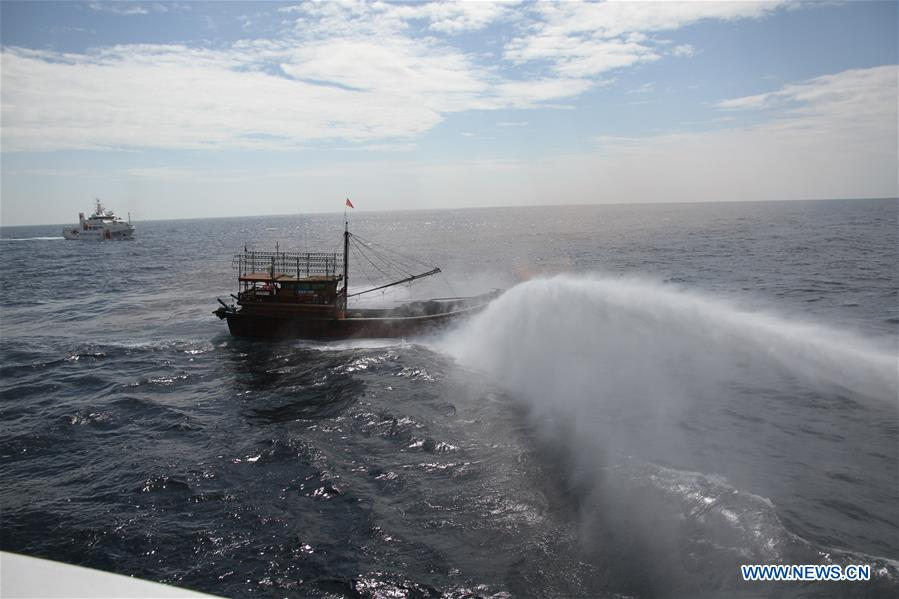 Coast guards from China and Vietnam put out fire in a drill in a common fishing zone in the Beibu Gulf, Nov. 7, 2016. China and Vietnam concluded a three-day joint patrol mission in a common fishing zone in the Beibu Gulf Wednesday. Coast guards from both sides completed a series of scheduled tasks, including a joint patrol, maritime search and rescue exercise, and examination of fishing boats, amid strong winds and high waves, according to a China Coast Guard (CCG) statement. (Xinhua/Bai Guolong)