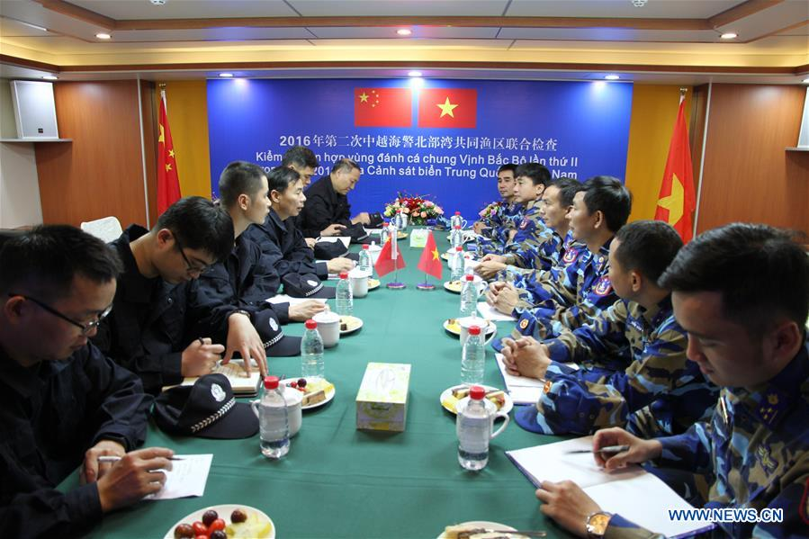 Members of coast guard from China and Vietnam communicate on a China Coast Guard ship in a common fishing zone in the Beibu Gulf, Nov. 8, 2016. China and Vietnam concluded a three-day joint patrol mission in a common fishing zone in the Beibu Gulf Wednesday. Coast guards from both sides completed a series of scheduled tasks, including a joint patrol, maritime search and rescue exercise, and examination of fishing boats, amid strong winds and high waves, according to a China Coast Guard (CCG) statement. (Xinhua/Bai Guolong)