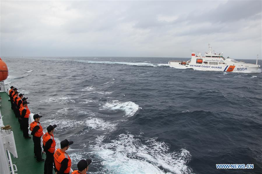 Coast guard ships from China and Vietnam sail in a common fishing zone in the Beibu Gulf, Nov. 7, 2016. China and Vietnam concluded a three-day joint patrol mission in a common fishing zone in the Beibu Gulf Wednesday. Coast guards from both sides completed a series of scheduled tasks, including a joint patrol, maritime search and rescue exercise, and examination of fishing boats, amid strong winds and high waves, according to a China Coast Guard (CCG) statement. (Xinhua/Bai Guolong)