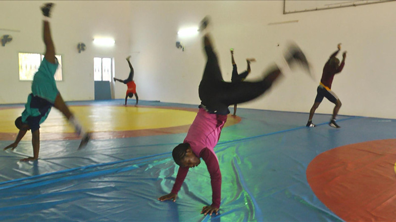 Isabel Sambou from Casamance Senegal close in view practising for the regional wrestling match.
