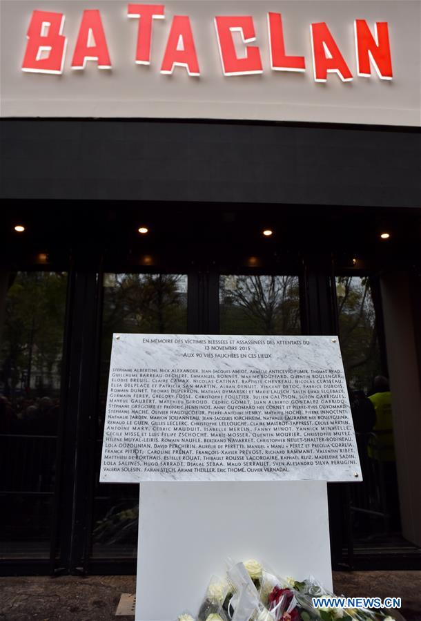 Photo taken on Nov. 13, 2016 shows a plaque in memory of victims in front of the Bataclan concert hall in Paris, France, Nov. 13, 2016. French President Francois Hollande opened a national day of commemoration one year after the terror attacks hit Paris. Commemorations were held on Sunday in the city at the places of the attacks which killed 130 people. (Xinhua/Thierry Mahe)