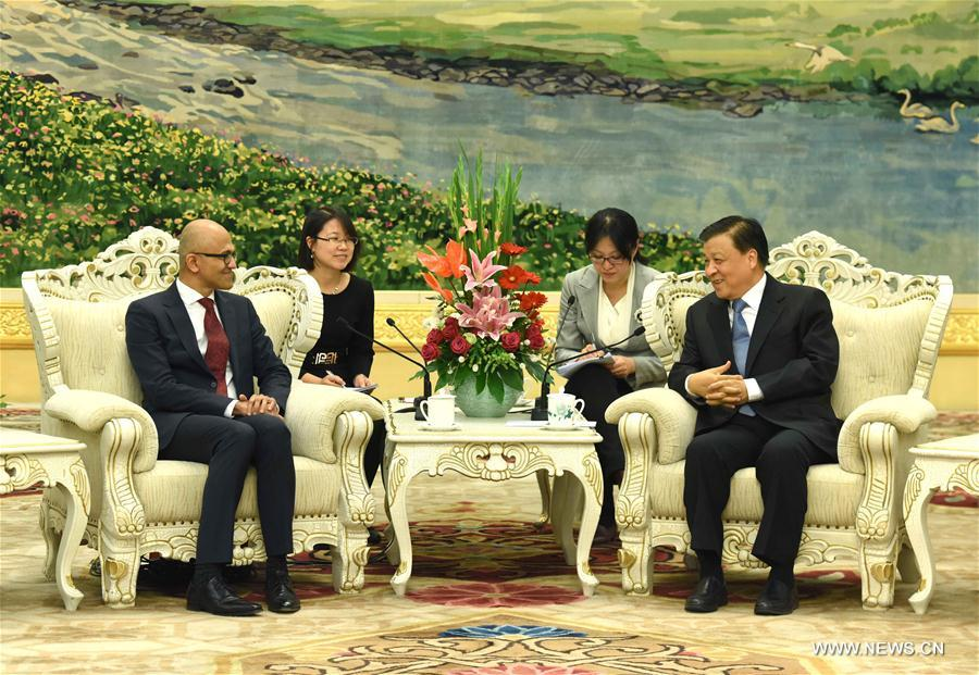 Liu Yunshan (R, front), a member of the Standing Committee of the Political Bureau of the Communist Party of China Central Committee, meets with Chief Executive Officer of Microsoft Satya Nadella in Beijing, capital of China, Nov. 14, 2016. (Xinhua/Rao Aimin)
