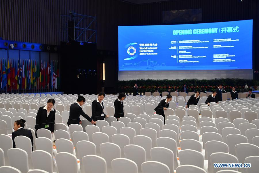 Staff members work inside the Wuzhen Internet International Conference and Exhibition Center in Wuzhen, east China