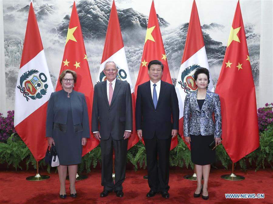 Chinese President Xi Jinping (2nd R) and his wife Peng Liyuan (R) pose for a group photo with Peru