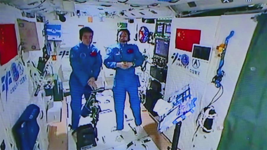 Photo provided by Astronaut Center of China shows Chinese astronauts Jing Haipeng (R) and Chen Dong accept their first earth-space interview in Tiangong-2, Nov. 15, 2016. Chinese astronauts Jing Haipeng and Chen Dong are currently on a 33-day space journey and acting as Xinhua special correspondents. On Tuesday, they talked with their copy desk on earth for the first time. (Xinhua)