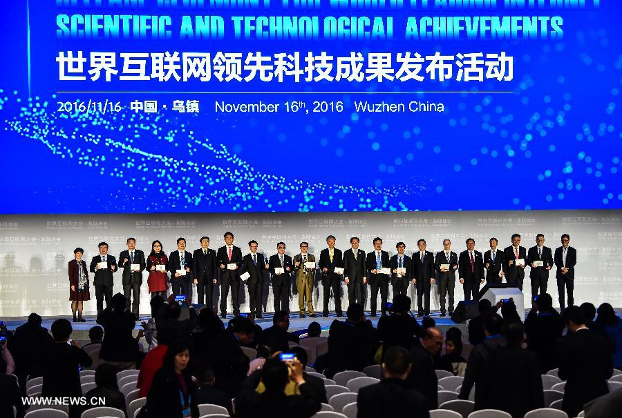 Representatives attending a release ceremony of world leading internet scientificand technological achievements pose for a group photo at the 3rd World Internet Conference in Wuzhen, east China