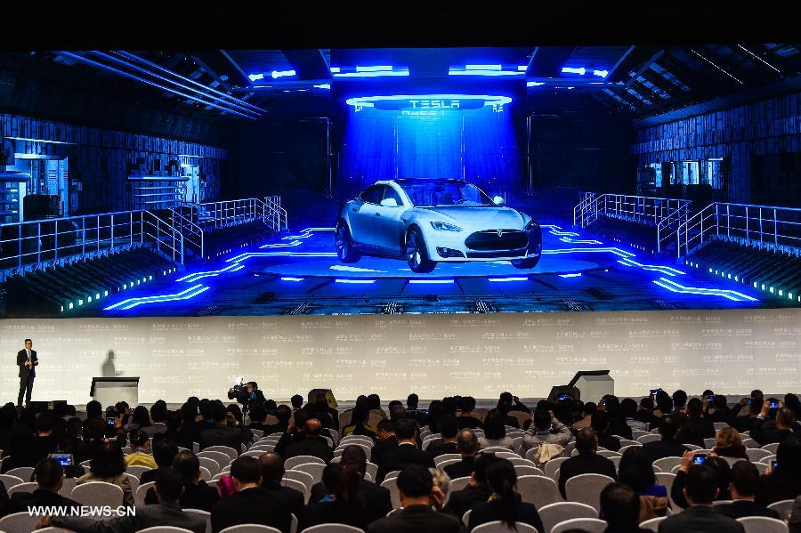 A representative of Tesla introduces an automated assistance driving system during a release ceremony of world leading internet scientific and technological achievements at the 3rd World Internet Conference in Wuzhen, east China