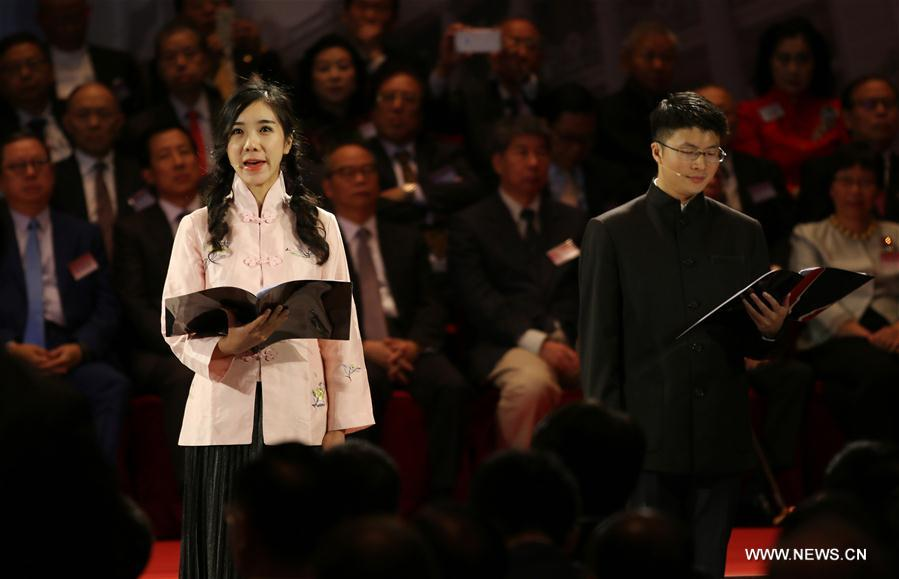 Performers read poems during a large-scale event commemorating the 150th anniversary of Sun Yat-sen