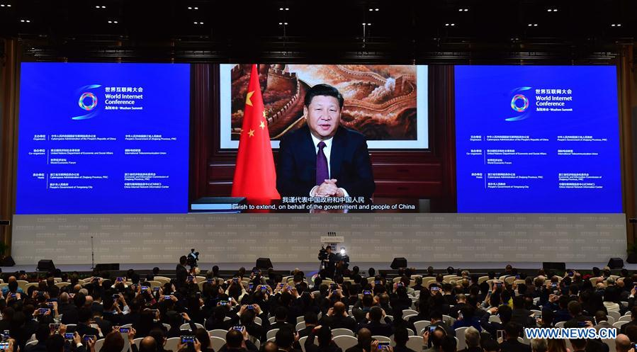 Chinese President Xi Jinping gives a speech via video at the opening ceremony of the third World Internet Conference (WIC) in Wuzhen, east China