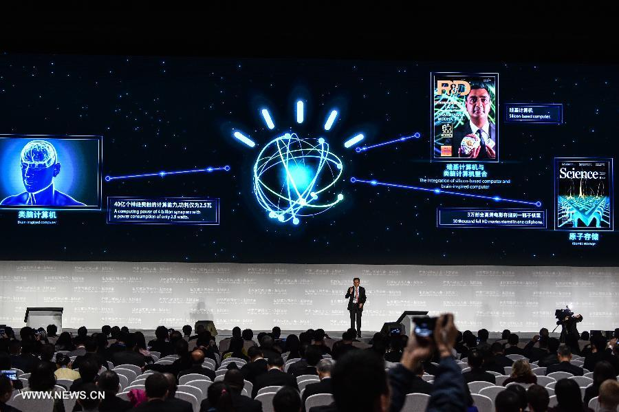 A representative of IBM introduces a brain-inspired computer during a release ceremony of world leading internet scientific and technological achievements at the 3rd World Internet Conference in Wuzhen, east China