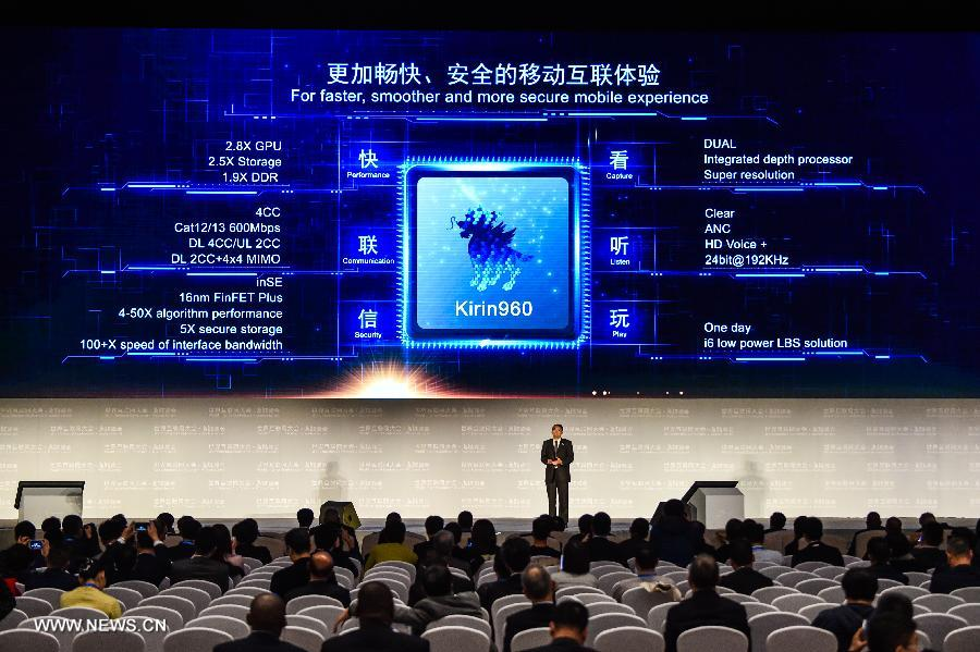 A representative of Huawei introduces Kirin 960 processor during a release ceremony of world leading internet scientific and technological achievements at the 3rd World Internet Conference in Wuzhen, east China