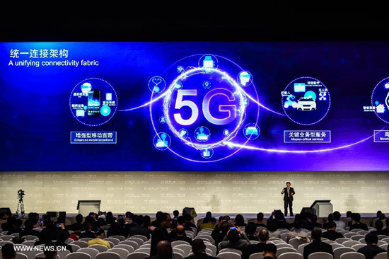 A representative of Qualcomm introduces 5G technology during a release ceremony of world leading internet scientific and technological achievements at the 3rd World Internet Conference in Wuzhen, east China