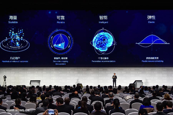 A representative of Alibaba Group introduces a big data cloud computing platform during a release ceremony of world leading internet scientific and technological achievements at the 3rd World Internet Conference in Wuzhen, east China