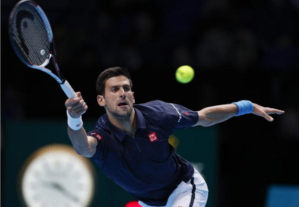 Novak Djokovic of Serbia returns the ball during the singles semifinal with Kei Nishikori of Japan at the 2016 ATP World Tour Finals at the O2 Arena in London, Britain on Nov. 19, 2016. Djokovic won 2-0. (Xinhua/Han Yan)
