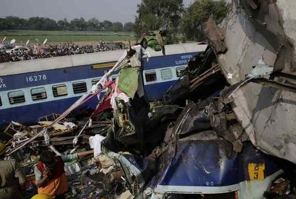 Rescuers work on the site of a train derailment accident in Kanpur Dehat, India, Sunday, Nov. 20, 2016. Many were killed Sunday when 14 coaches of an overnight passenger train rolled off the track in northern India, with rescue workers using cutting torches to try to pull out survivors, police said. AP Photo/Rajesh Kumar Singh