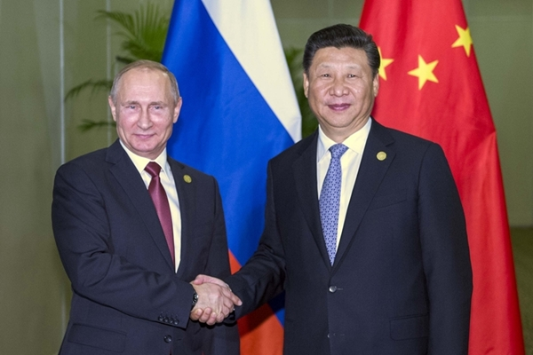 الرئيس الصيني شي جين بينغ يلتقي الرئيس الروسي فلاديمير بوتين