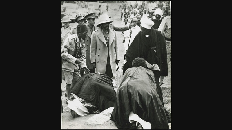 Ethiopians bowing before Emperor Haile Selassie. He was much revered and considered a god by the Ethiopians.