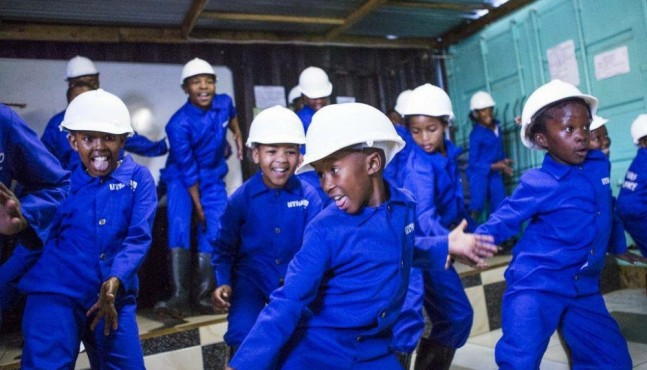 In an effort to help children deal with the violence around them, kids meet after school in this small garage where they learn traditional gumboot dancing.