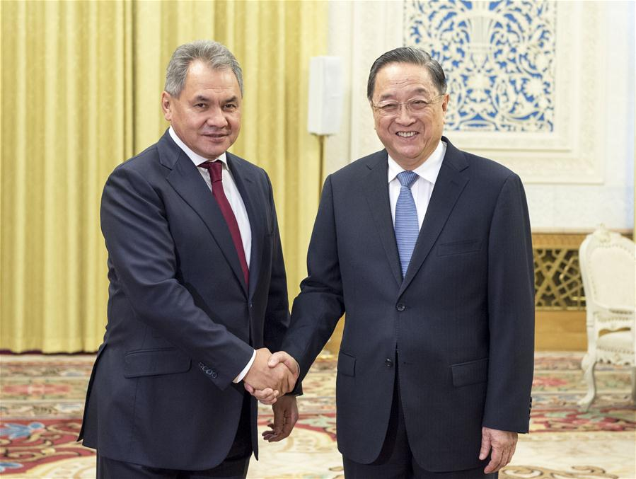 Yu Zhengsheng (R), chairman of the National Committee of the Chinese People