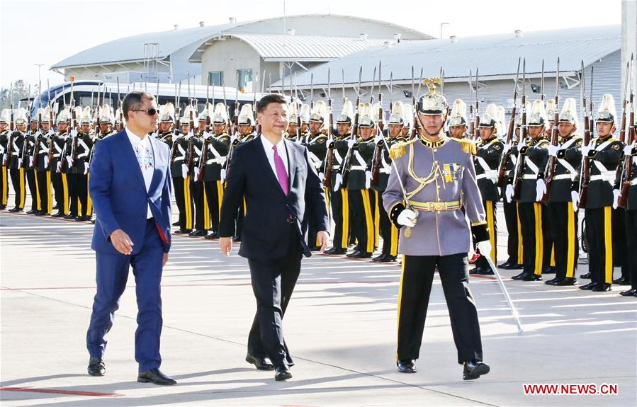 Chinese President Xi Jinping (C) attends a welcoming ceremony held by Ecuadorian President Rafael Correa (L) at the airport in Quito, Ecuador, Nov. 17, 2016. Xi arrived here Thursday for a state visit to Ecuador. (Xinhua/Ju Peng)