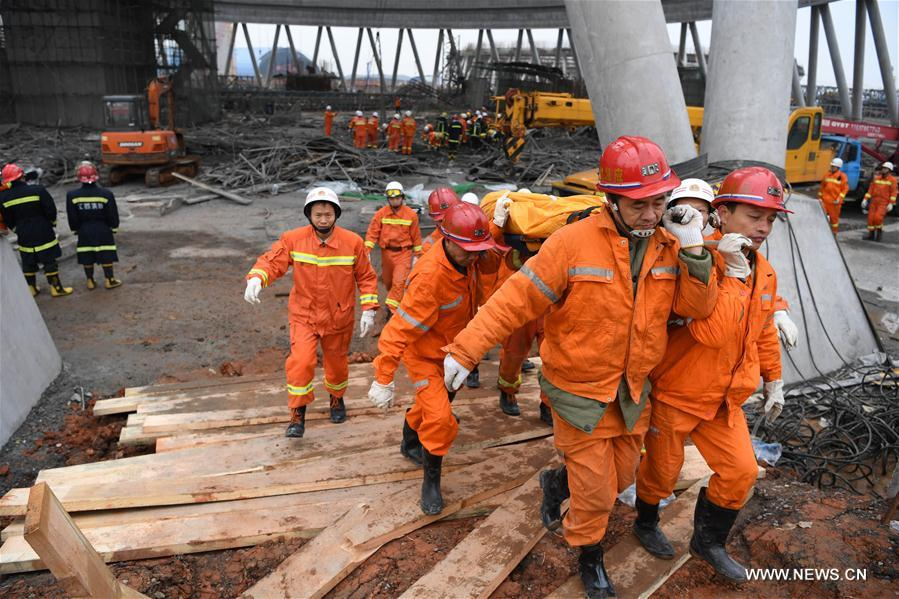 Rescuers work at the accident site at the Fengcheng power plant in Yichun City, east China