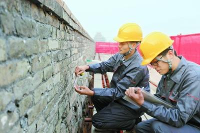 The walls of the ancient imperial center of power that is now the Palace Museum in Beijing are showing signs of aging, like loose bricks and cracking surfaces.