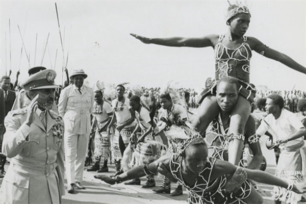 Emperor Haile Selassie salutes the entertainers.