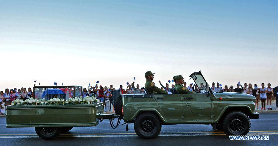 The caravan carrying the urn that holds the ashes of Cuban revolutionary leader Fidel Castro is greeted by people at Malecon Habanero Avenue in Havana, capital of Cuba, on Nov. 30, 2016. On Wednesday, Fidel Castro