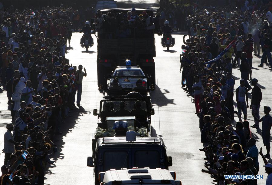 People line the street to bid farewell to the caravan carrying the ashes of Cuban revolutionary leader Fidel Castro on the outskirts of Havana, capital of Cuba, on Nov. 30, 2016. On Wednesday, Fidel Castro
