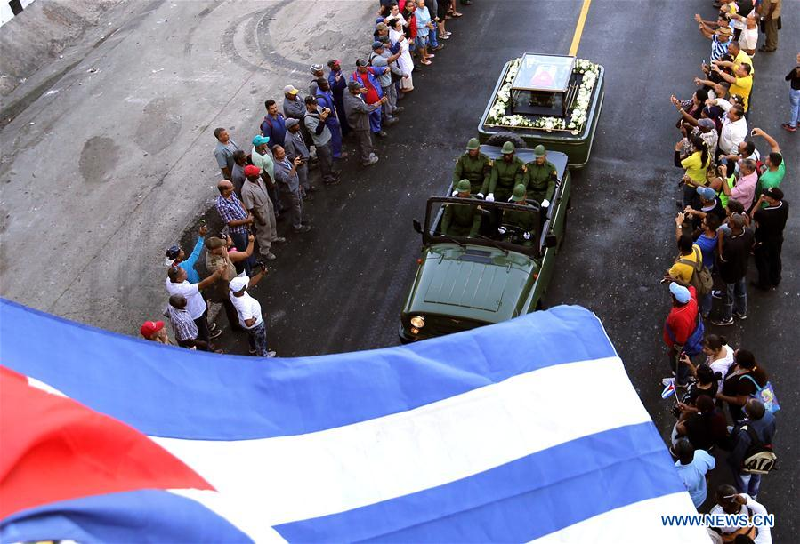 People line the street to bid farewell to the caravan carrying the ashes of Cuban revolutionary leader Fidel Castro on outskirts of Havana, capital of Cuba, on Nov. 30, 2016. On Wednesday, Fidel Castro