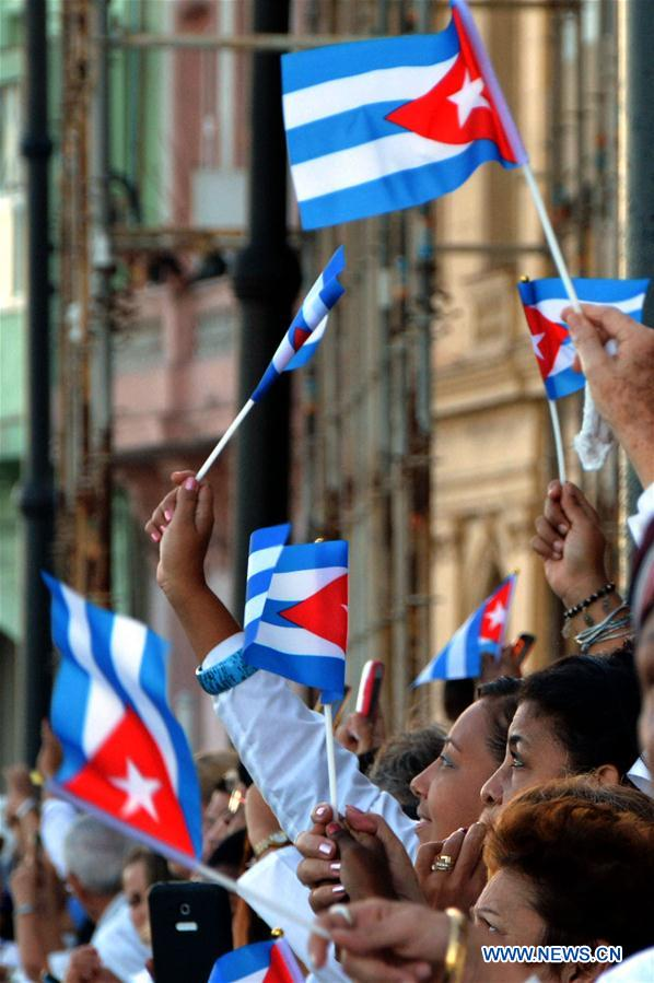 People gather to greet the motorcade that escorts the ashes of Cuban revolutionary leader Fidel Castro, at Malecon Habanero Avenue in Havana, capital of Cuba, on Nov. 30, 2016. On Wednesday, Fidel Castro