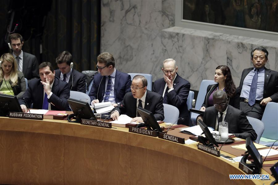 United Nations (UN) Secretary-General Ban Ki-moon (C, front) speaks after the UN Security Council adopted a resolution in response to DPRK