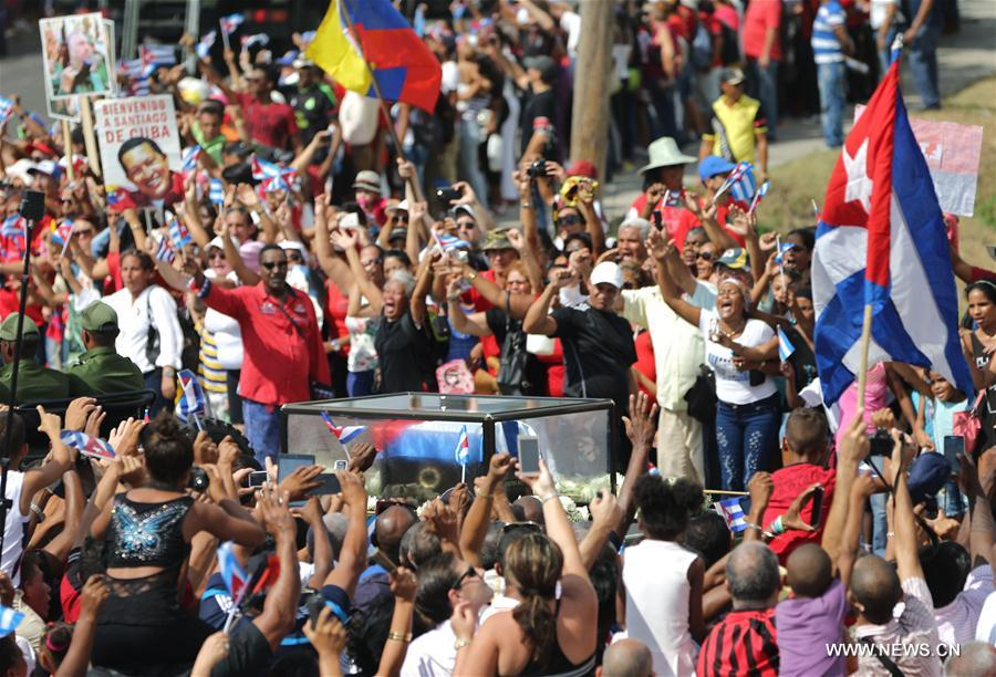 People greet the caravan carrying the ashes of Cuban revolutionary leader Fidel Castro upon its arrival in Santiago de Cuba, southeastern Cuba, on Dec. 3, 2016. As the caravan carrying the ashes of Fidel Castro reached its final destination in Santiago De Cuba, hundreds of thousands of Cubans had come together over the last four days to bid farewell to the revolution leader. Fidel Castro passed away on Nov. 25 at the age of 90. (Xinhua/David de la Paz)