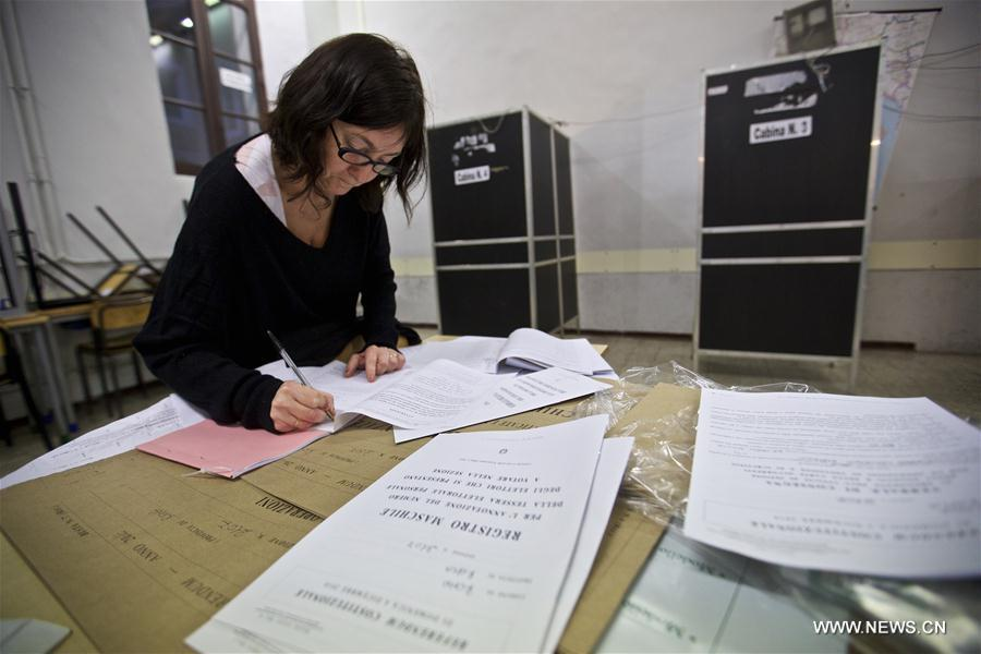 A staff member of a polling station checks information on the eve of the constitutional referendum in Rome, capital of Italy, on Dec. 3, 2016. On Dec. 4, voters will be called to have their say on a constitutional reform package, which the parliament had already approved with six consecutive readings in over two and a half years long debate. (Xinhua/Jin Yu)
