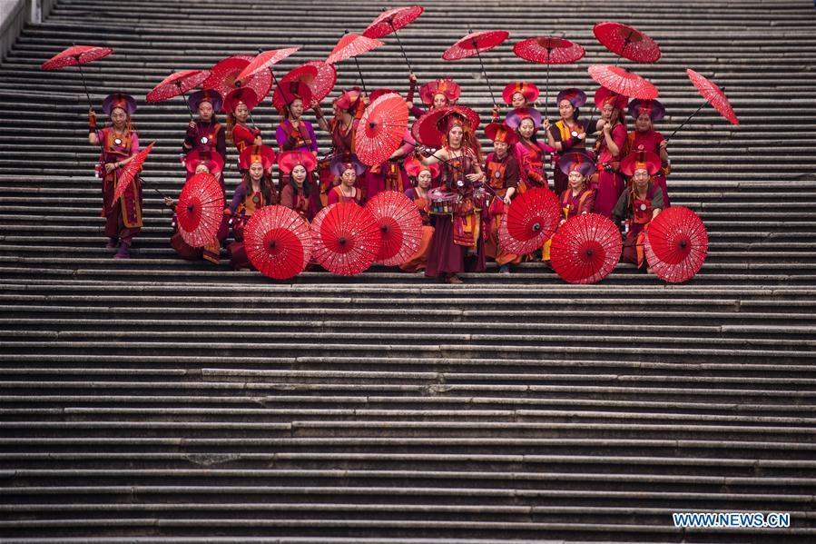 "Actresses take part in the ""Parade through Macao, Latin City"" in Macao, south China, Dec. 4, 2016. The parade was held here on Sunday to mark the 17th anniversary of Macao"