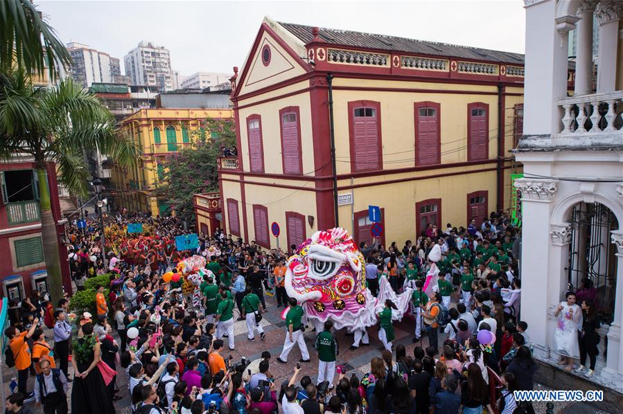 "People watch the ""Parade through Macao, Latin City"" in Macao, south China, Dec. 4, 2016. The parade was held here on Sunday to mark the 17th anniversary of Macao"