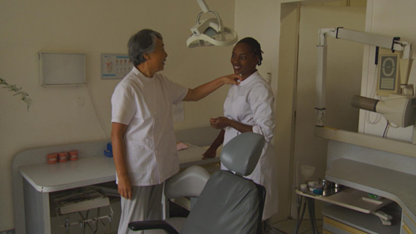 Dr. Gao with Faith, her assistant dentist.
