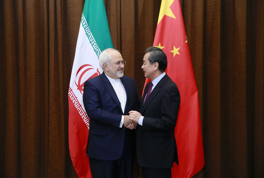 Chinese Foreign Minister Wang Yi (R) shakes hands with his Iranian counterpart Mohammad Javad Zarif in Beijing, capital of China, Dec. 5, 2016. Wang and Zarif co-chaired the first annual foreign ministers