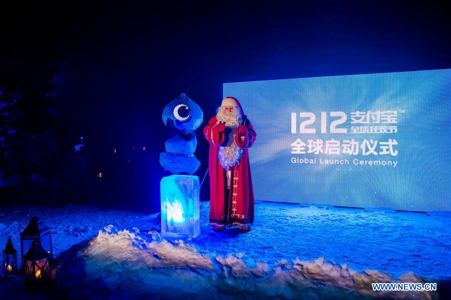 A ceremony is held at Santa Village to activate the global campaign of Alipay 1212 in Rovaniemi, Finland, Dec. 5, 2016. Alipay, the payment service of China