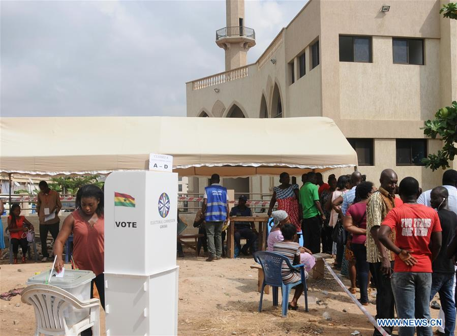 A voter casts her ballot in Accra, Ghana, on Dec. 7, 2016. Ghana