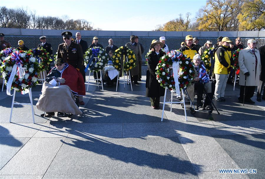 Pearl Harbor survivor veterans attend the 75th anniversary commemoration of Pearl Harbor attack, at the National World War II Memorial in Washington D.C., the United States, Dec. 7, 2016. (Xinhua/Yin Bogu)
