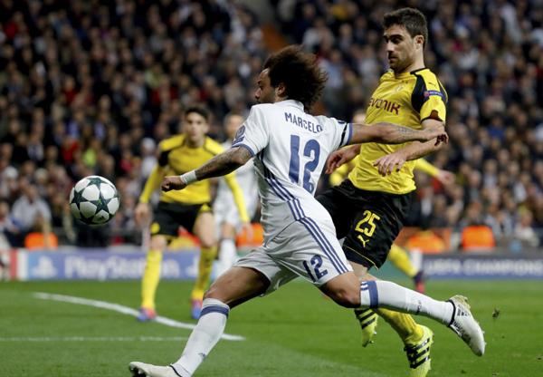 Fútbol: El Real Madrid empata (2-2) ante el Dortmund y no puede arrebatarle el primer puesto del grupo