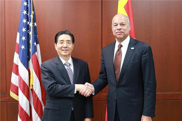 Chinese State Councilor and Minister of Public Security Guo Shengkun (L) shakes hands with U.S. Secretary of Homeland Security Jeh Johnson in Washington, the United States, on Dec. 7, 2016.