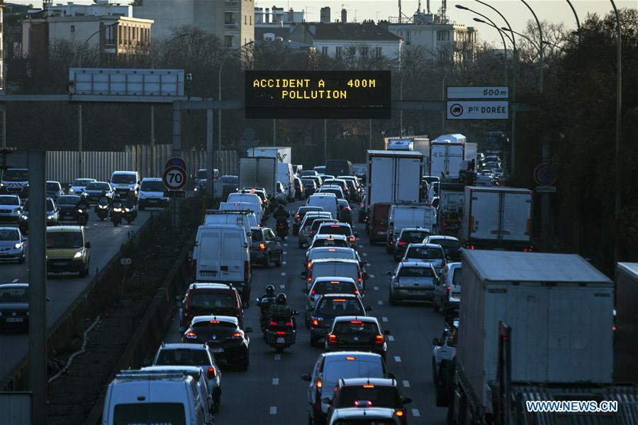 "Photo taken on Dec. 8, 2016 shows a traffic billboard reading ""pollution"" on a road in Paris, France. Vehicles are to be banned from circulating in Paris and in 22 neighboring municipalities on Friday for the fourth successive day due to poor air quality, the city authorities said on Thursday. (Xinhua/Theo Duval)"